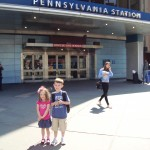 Nate and Kenzie pose in front of Penn Station - first time to NYC!