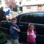 Nate and Kenzie pose in front of our car