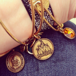 Adding to my @AlexandAni Collection with a Disneyland Charm Bracelet #DisneySMMoms